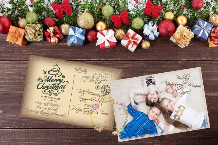 Christmas decorations and gift boxes on wooden board background with copy space